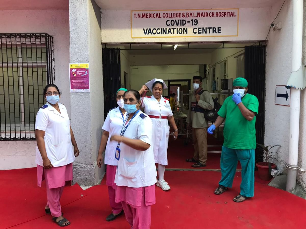 Nurses and healthcare workers at Nair Hospital, one of the designated Covid vaccination centres in Mumbai. (Photographer: Vijay Sartape/BloombergQuint)