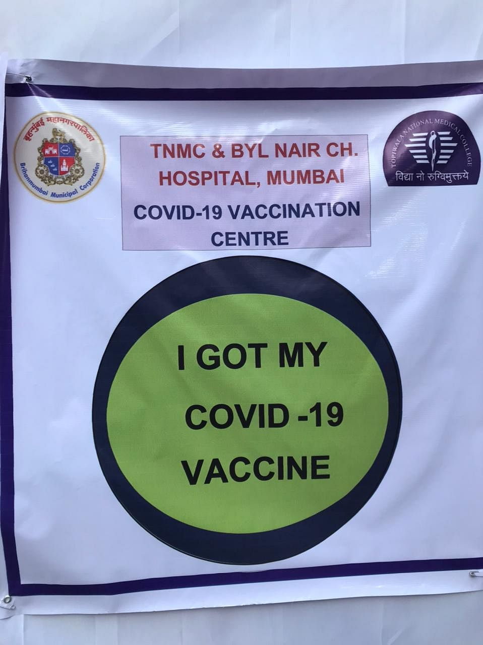 """I got my Covid-19 vaccine"" printed on a poster at Nair Hospital, one of the designated Covid vaccination centres in Mumbai. (Photographer: Vijay Sartape/BloombergQuint)"