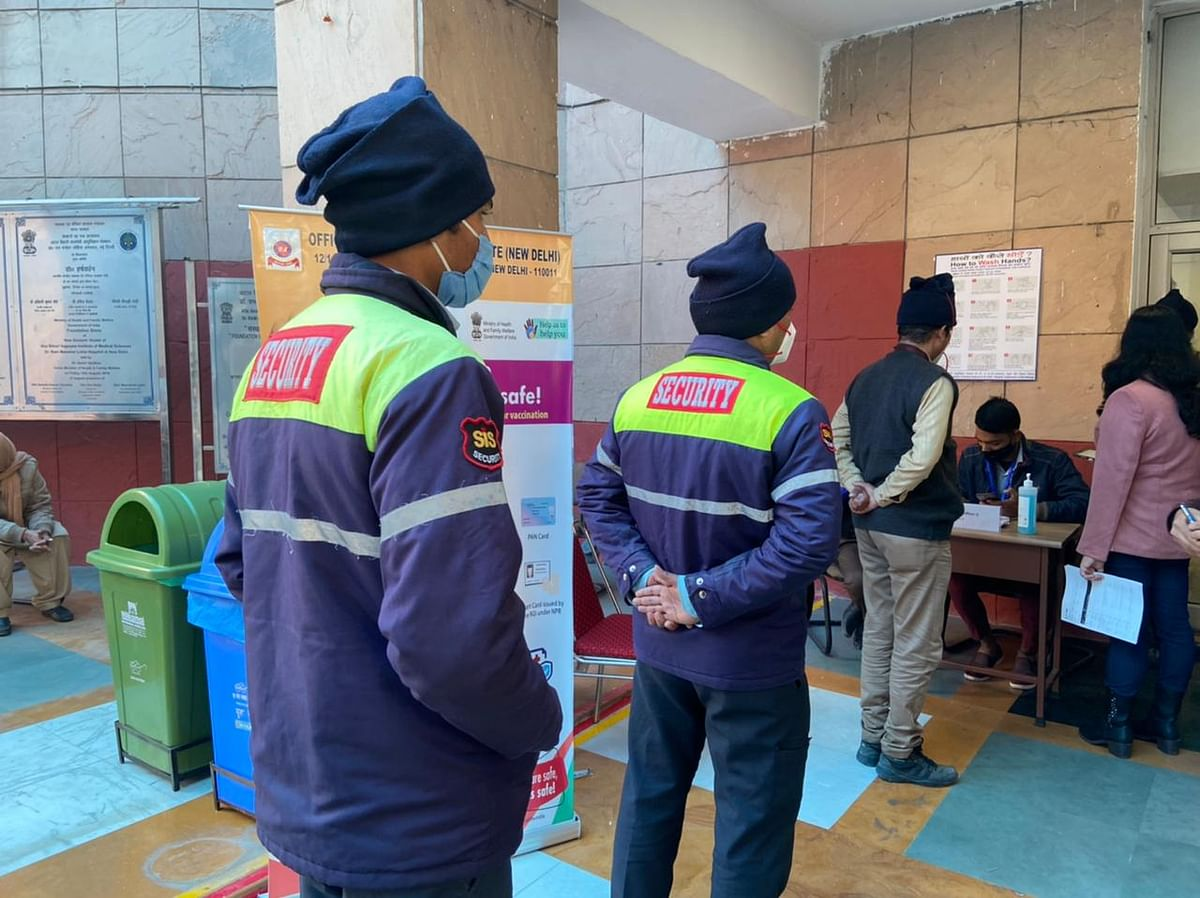 Frontline workers get registered for the Covid vaccine at RML Hospital in Delhi. (Photographer: Nishant Sharma/BloombergQuint)