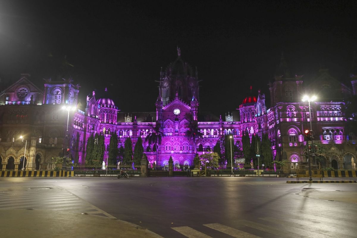 The Chhatrapati Shivaji Maharaj Terminus (CSMT) stands illuminated during a lockdown imposed due to the coronavirus at night in Mumbai, India, on Wednesday, March 25, 2020. (Photographer: Dhiraj Singh/Bloomberg)