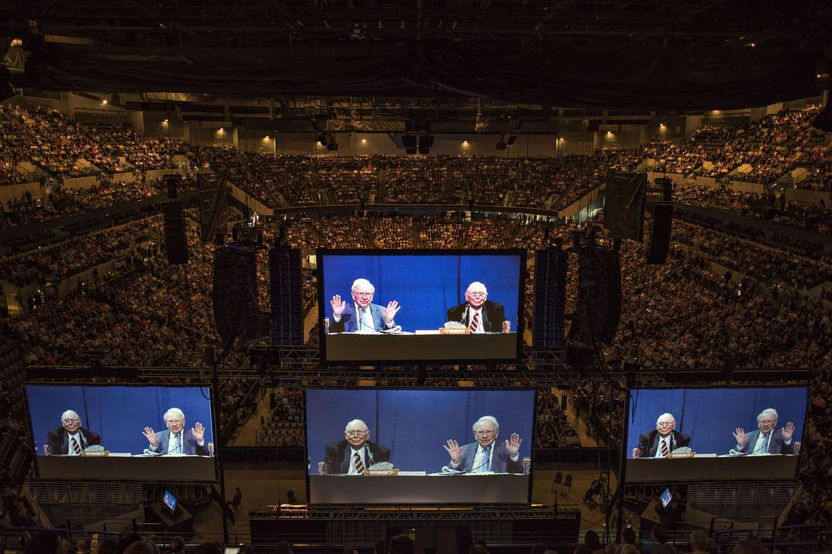 A Berkshire Hathaway shareholder meeting in 2015 with Warren Buffett, Berkshire Hathaway Inc. chairman and chief executive officer, and Charles Munger, vice chairman of Berkshire Hathaway Inc., projected on large screens. (Photographer: Daniel Acker/Bloomberg)