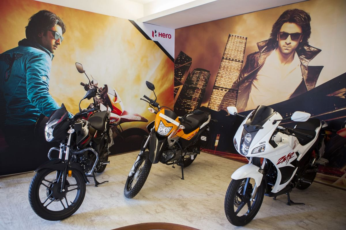 Hero MotorCorp Ltd.'s Xtreme, left, Impulse, center, and Karizma ZMR motorcycles sit on display in the reception of the company's manufacturing facility in Gurgaon, India. (Photographer: Prashanth Vishwanathan/Bloomberg)