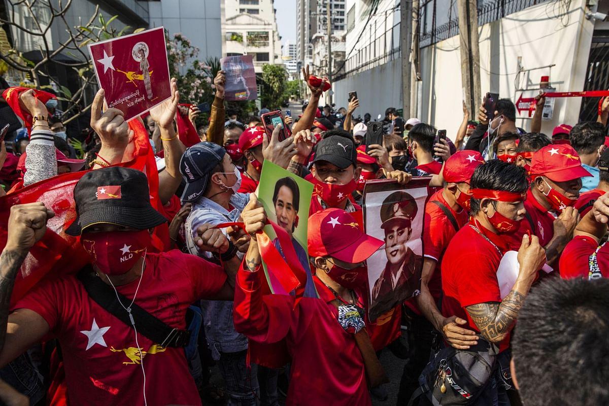 Demonstrators  protest outside the Embassy of Myanmar in Bangkok, on Feb. 1, 2021. (Photographer: Andre Malerba/Bloomberg)