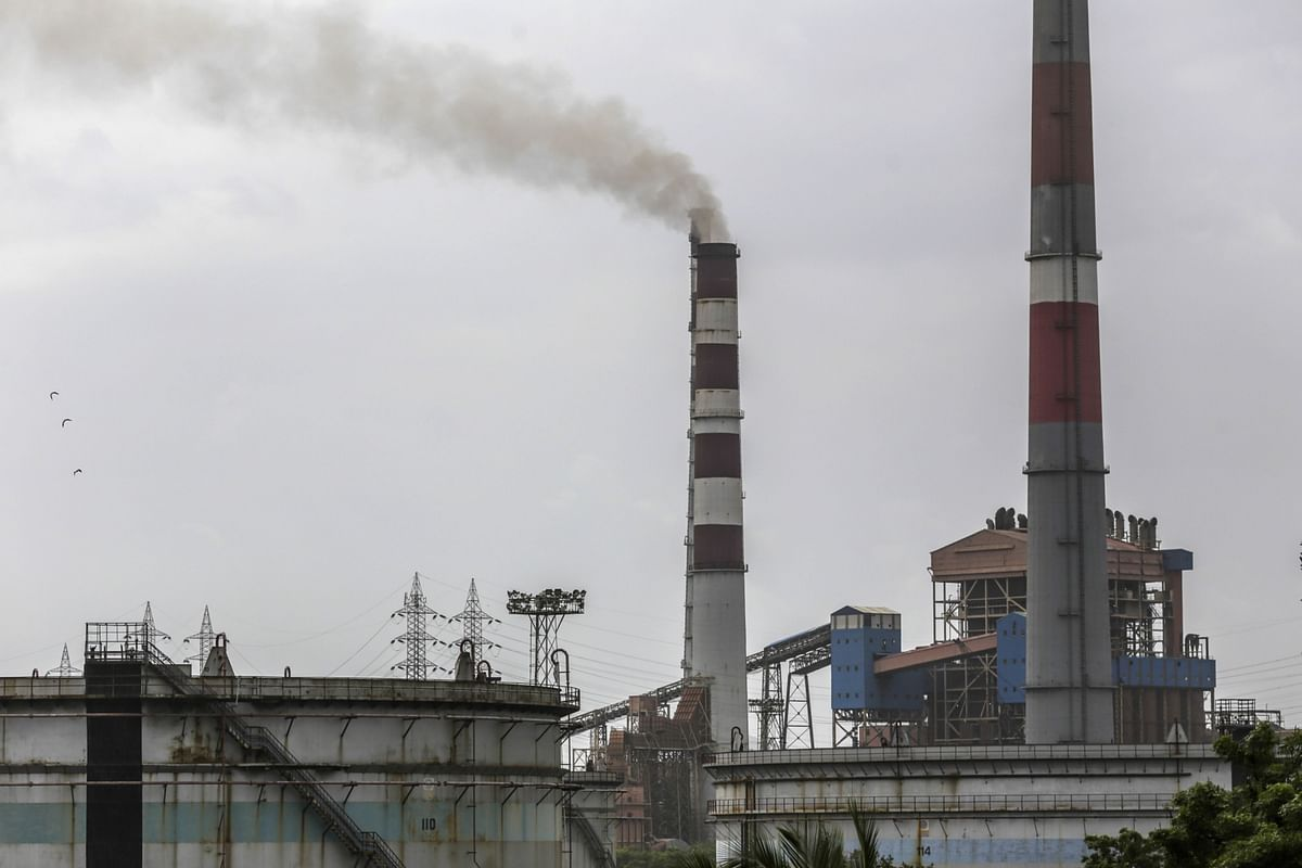 A chimney stands at a thermal power station in India. (Photographer: Dhiraj Singh/Bloomberg)