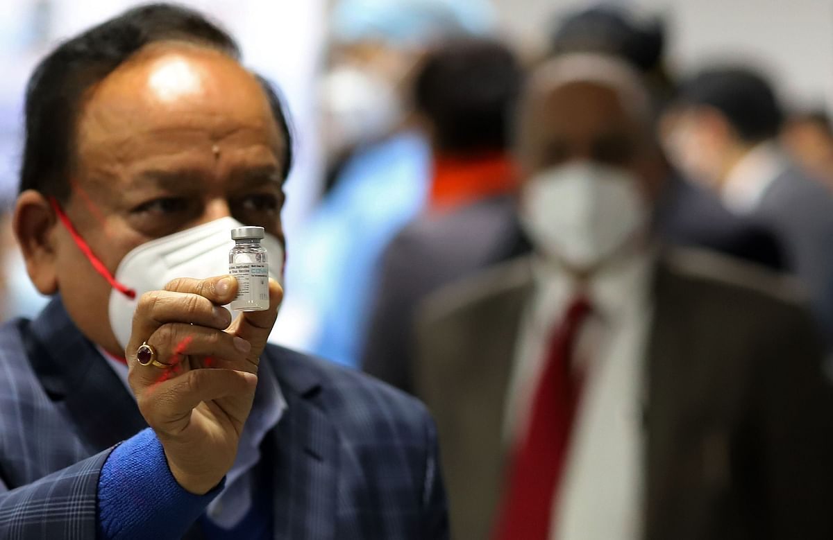Harsh Vardhan, India's health minister, displays a vial of Covaxin at AIIMS in New Delhi, on Jan. 16, 2021. (Photographer: Anindito Mukherjee/Bloomberg)