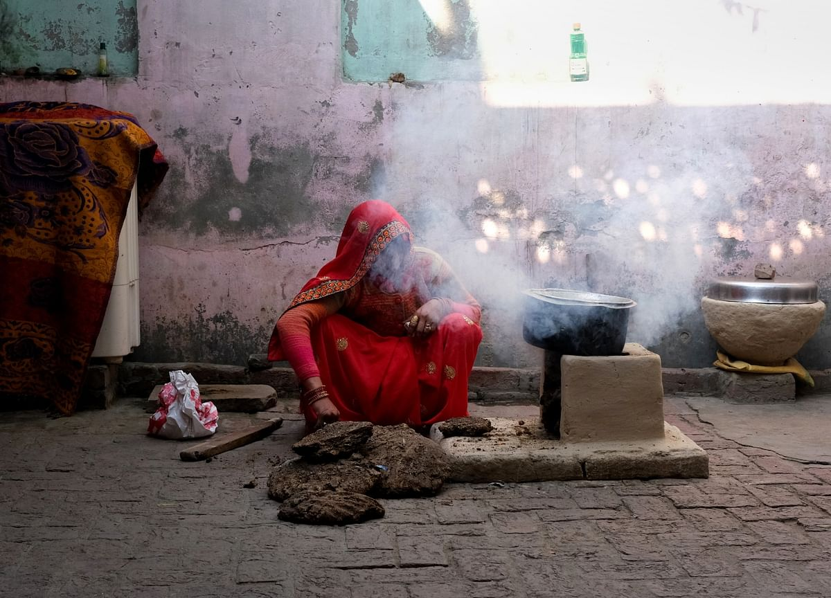 Millions Of Women Face Health Risk From Cuts to Modi's Fuel Plan