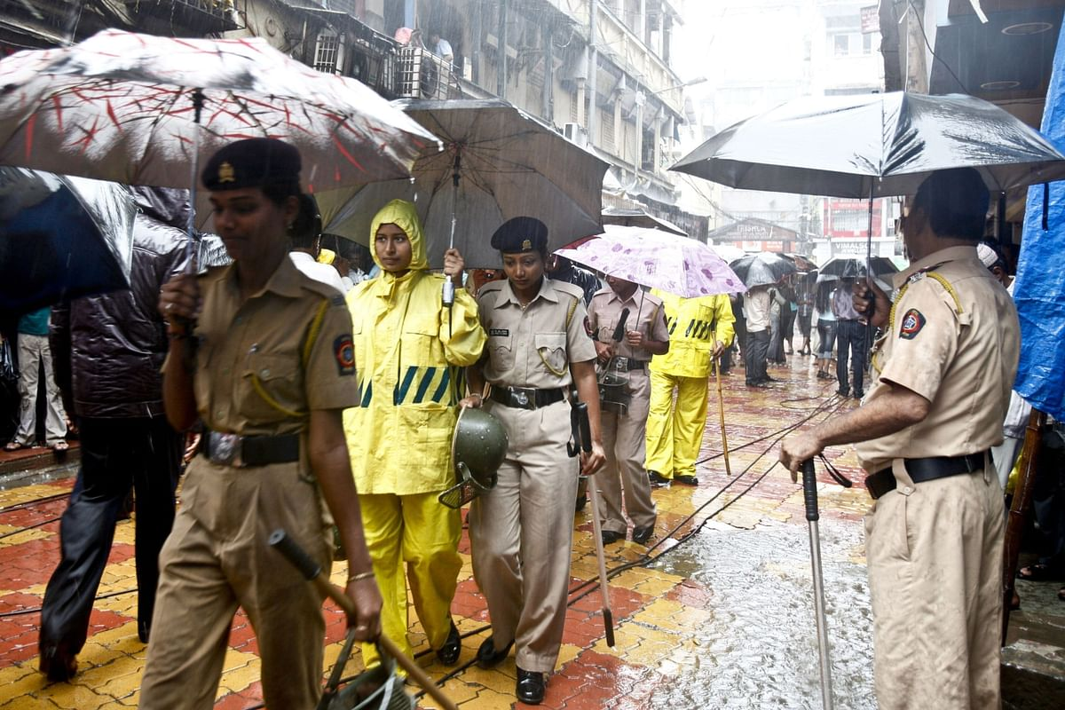 Police officers patrol the area of Zaveri Bazaar in Mumbai, on July 14, 2011, a day after three bombings in India's financial capital. (Photographer: Kainaz Amaria/Bloomberg)