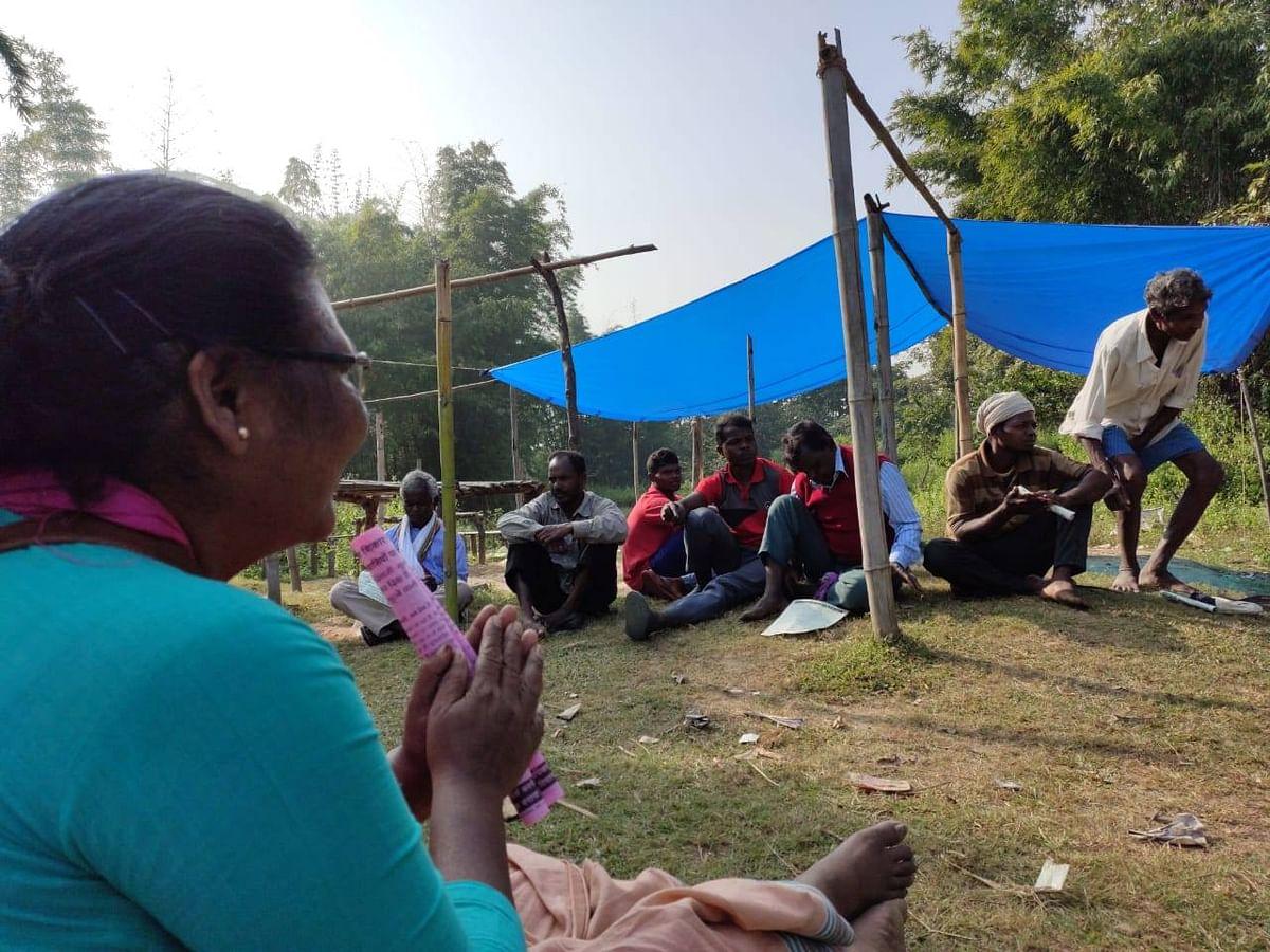 Dayamani Barla, left, meets with Adivasis-Moolvasis in the district of Kunthi, Jharkhand, on Dec. 1, 2019. (Photograph: Dayamani Barla Official/Twitter)