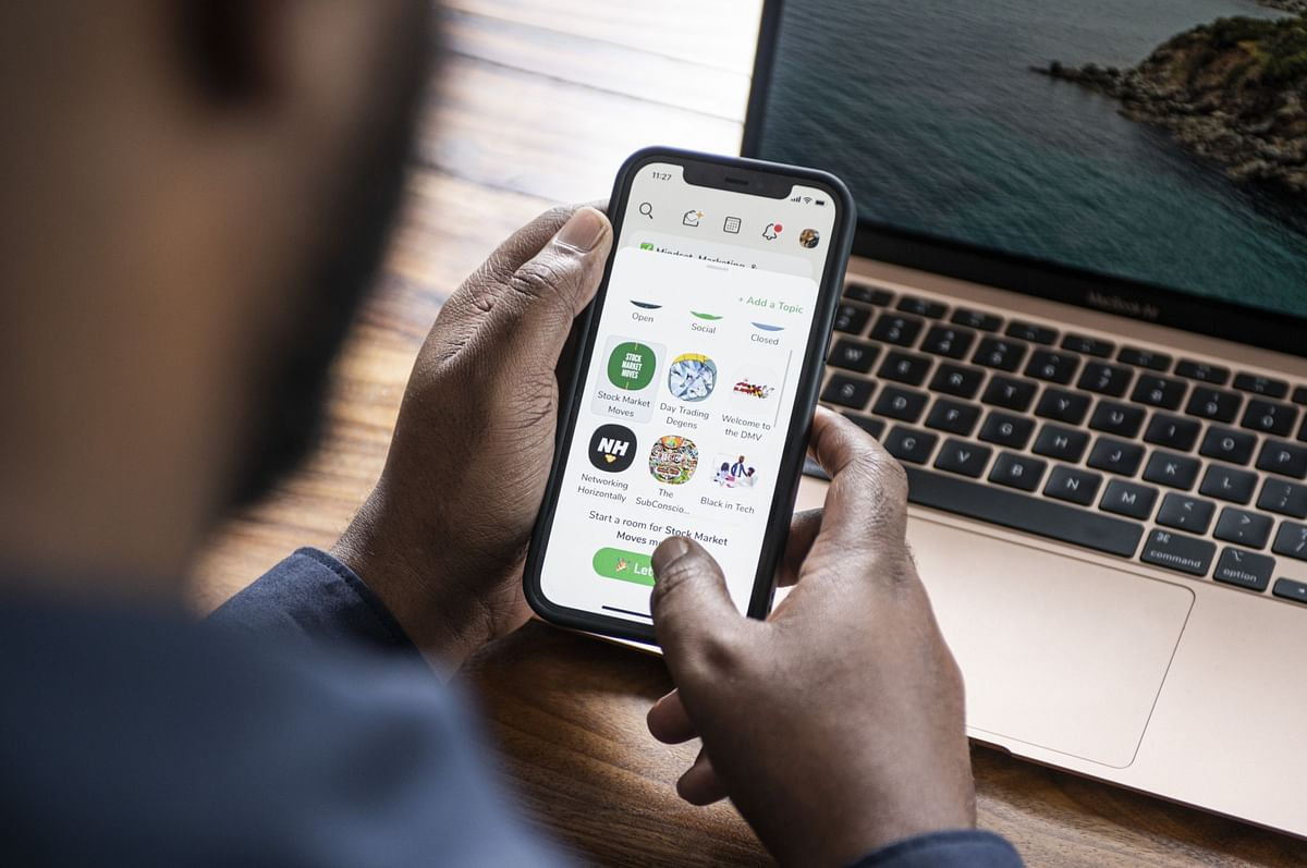 """Dion Foxworth, co-host of the """"Stock Market Moves"""" show, uses the Clubhouse app, in Johannesburg, on Feb. 12 2021. (Photographer: Waldo Swiegers/Bloomberg)"""