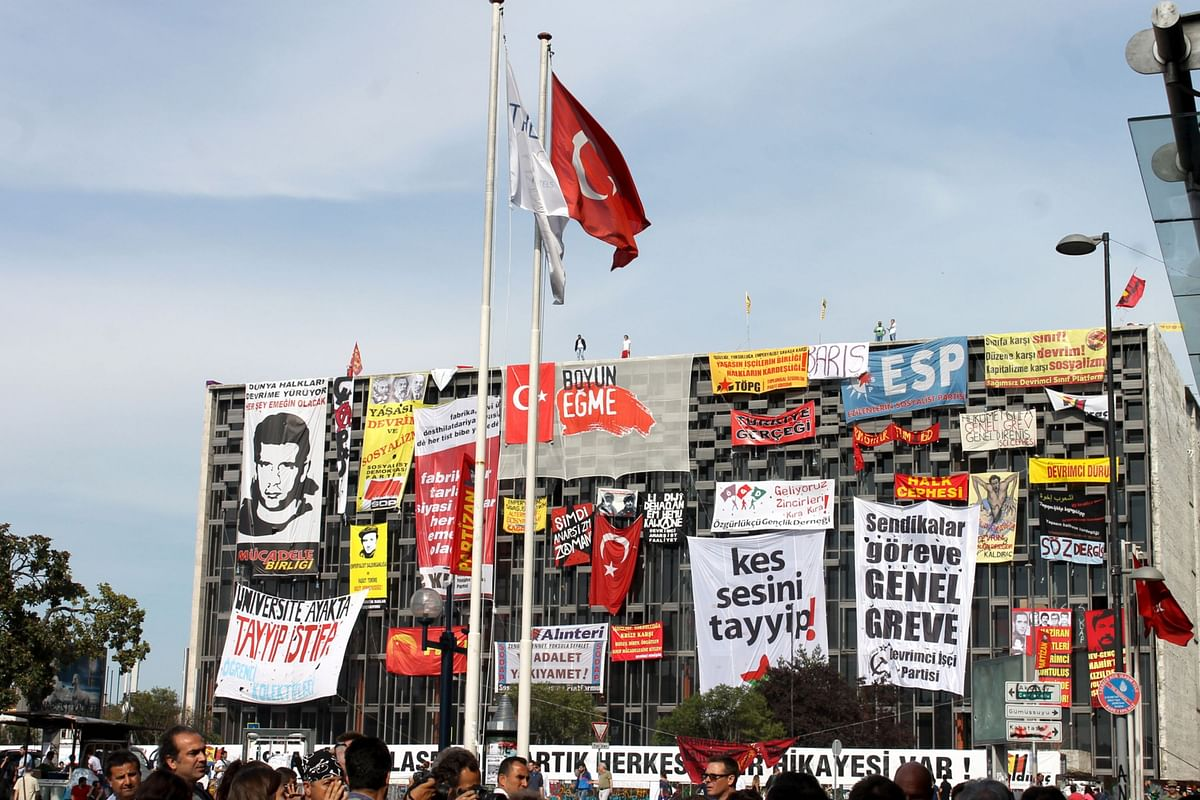 Posters protesting against Recep Tayyip Erdogan adorn a building near Taksim Square in Istanbul, Turkey, on June 6, 2013. (Photographer: Jeremy Gerard/Bloomberg)