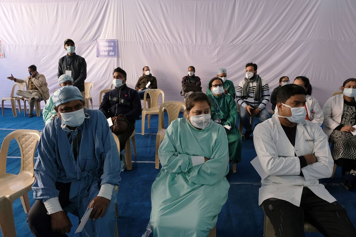 Healthcare workers wait ahead of their Covid-19 vaccination, at a hospital in New Delhi, on Jan. 16, 2021. (Photographer: T. Narayan/Bloomberg)
