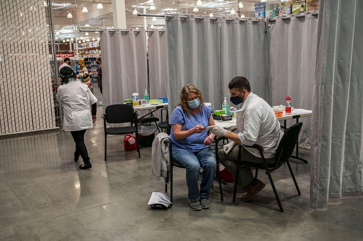 N.Y. Eases Travel Quarantine; Biden Signs Stimulus: Virus Update