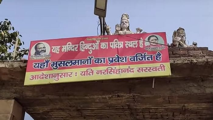 Board put up outside Dasna Devi Temple, in Ghaziabad, Uttar Pradesh. (Photograph: The Quint)