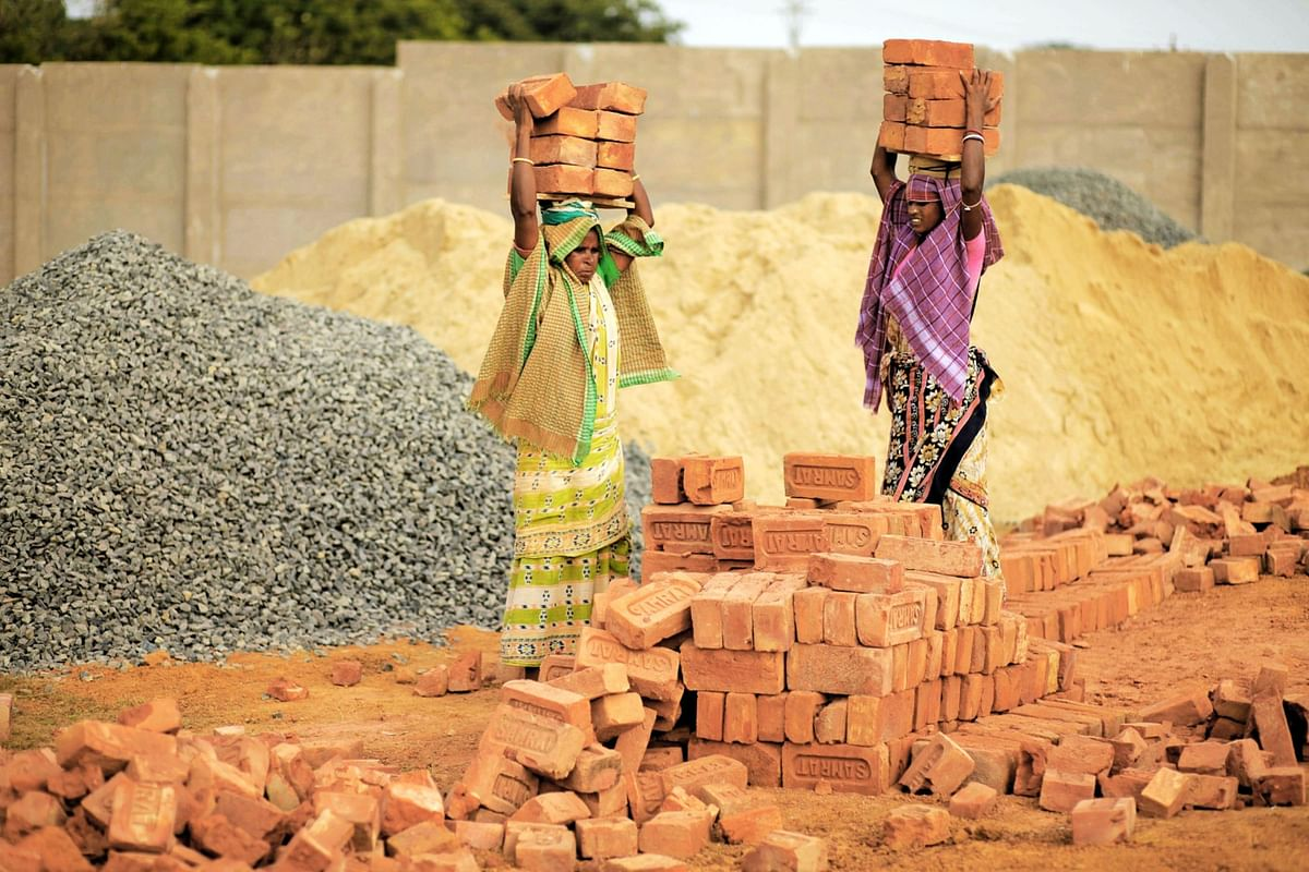 Women carry bricks at the site of a steel plant, on Nov. 18, 2010. (Photographer: Adeel Halim/Bloomberg)