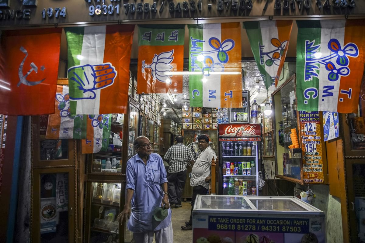 CPI, Congress, BJP, and Trinamool  flags, are displayed for sale at a store in Kolkata, on April 30, 2019. (Photographer: Prashanth Vishwanathan/Bloomberg)