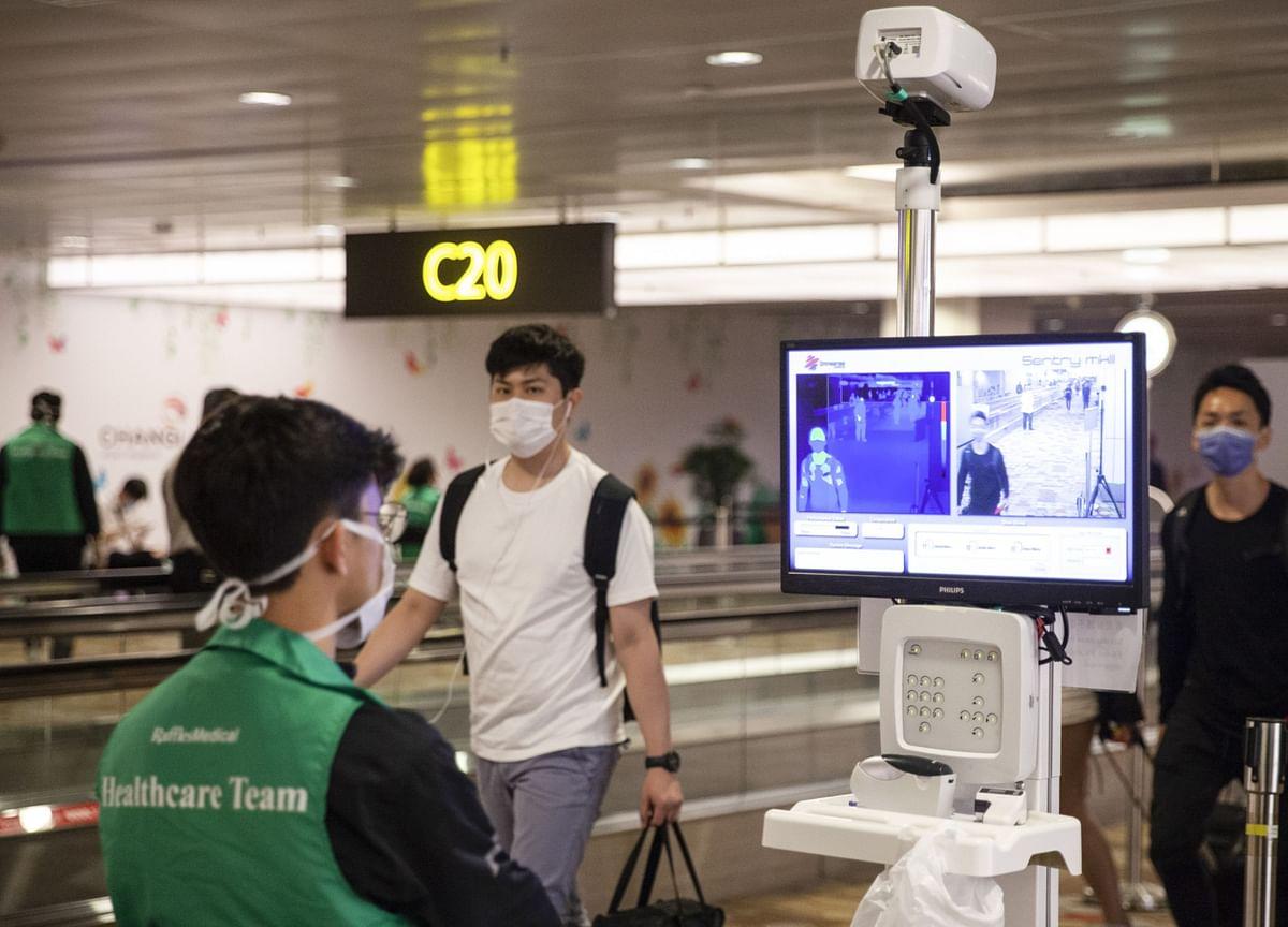 Singapore, UAE to Bar Travelers From India on Virus Threat