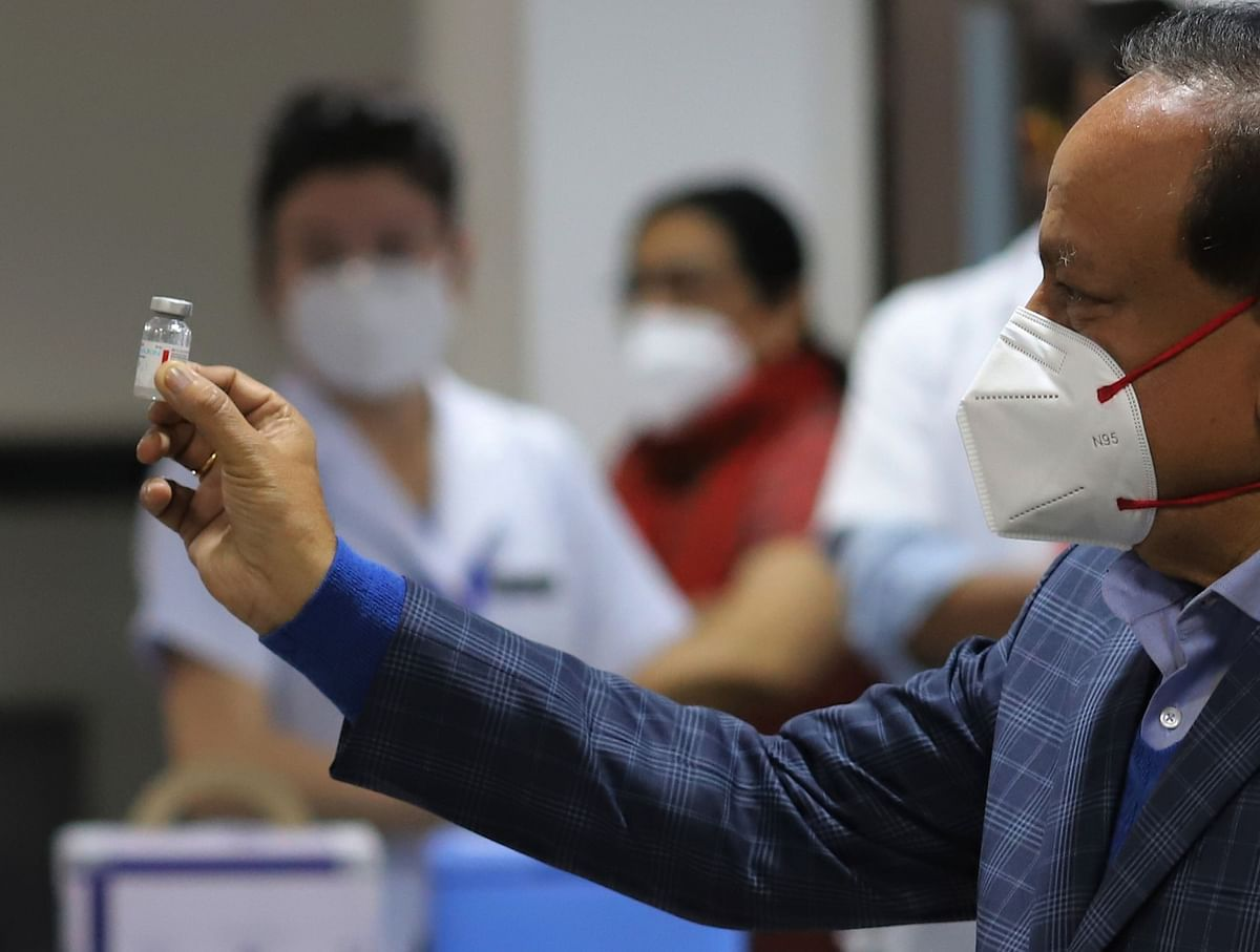 Harsh Vardhan, India's health minister, displays a vial of Covaxin, at  AIIMS in New Delhi, on Jan. 16, 2021. (Photographer: Anindito Mukherjee/Bloomberg)