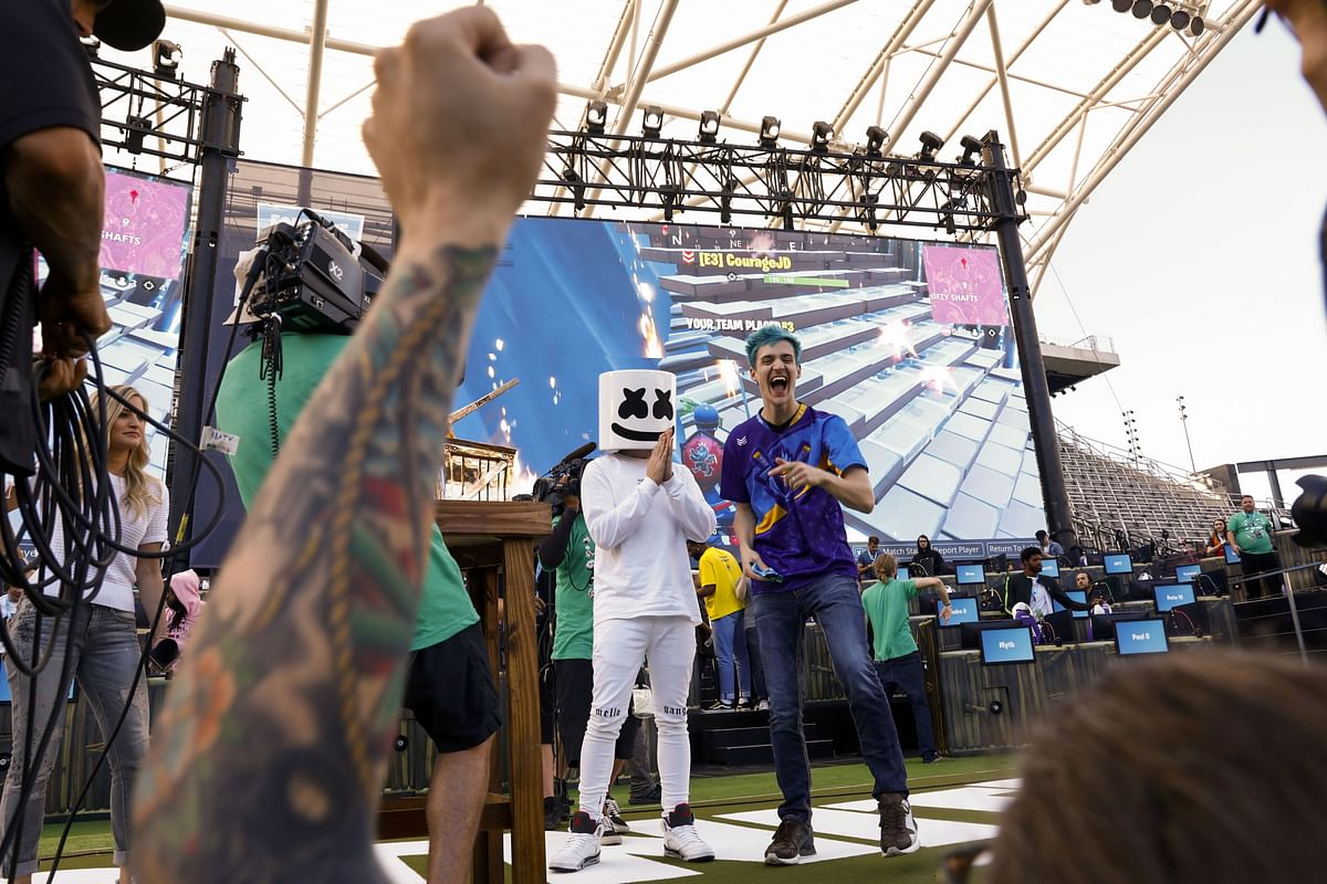 """<div class=""""paragraphs""""><p>Tyler Blevins, with DJ Christopher Comstock, known as Marshmello, after winning the  Fortnite: Battle Royale Celebrity Pro Am in 2018. (Photographer: Patrick T. Fallon/Bloomberg)</p></div>"""