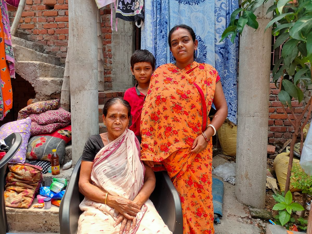 Right to Left: Suman Nandy, standing next to her mother seated on the chair, and her son.