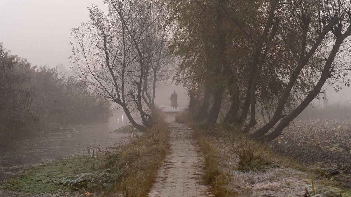 "<div class=""paragraphs""><p>A pedestrian walks along a path next to a causeway in Srinagar. (Photographer: Sumit Dayal/Bloomberg)</p></div>"
