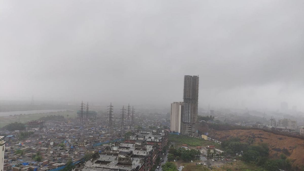 "<div class=""paragraphs""><p>Dark clouds engulf area near Mumbai Harbour in Wadala. (Source: BloombergQuint)</p></div>"