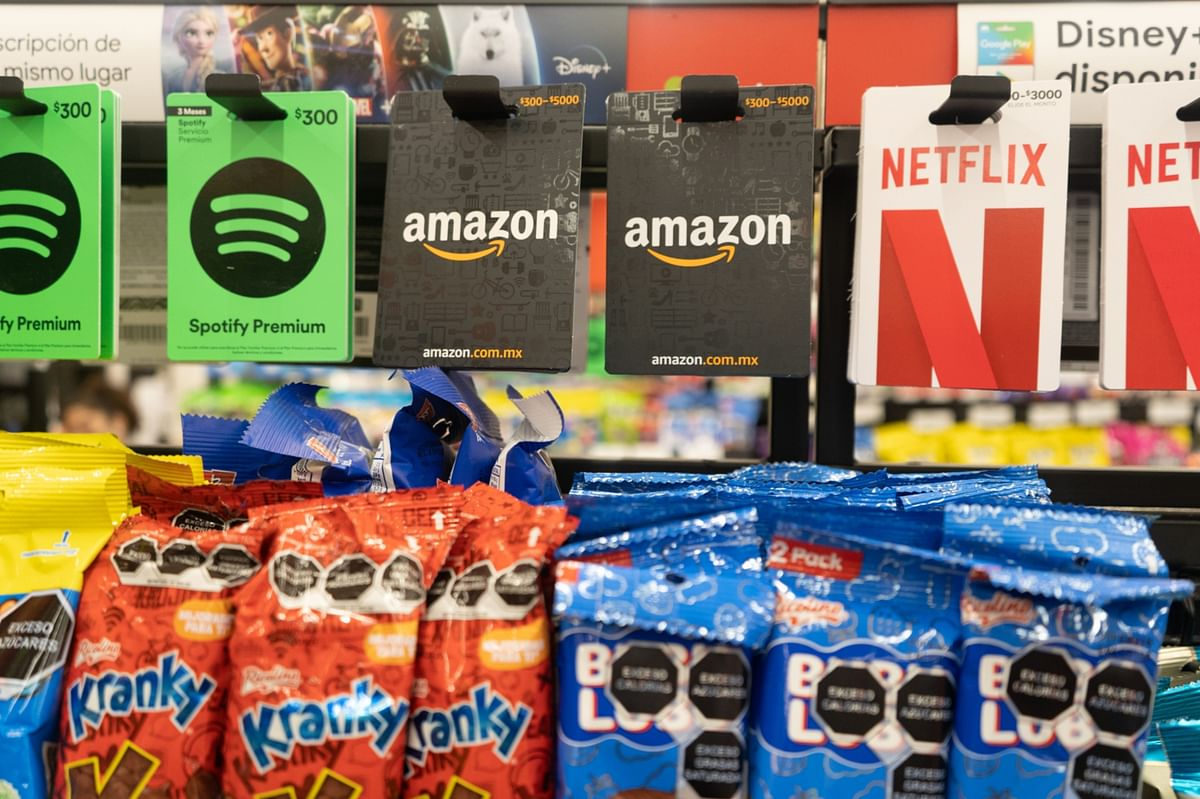 """<div class=""""paragraphs""""><p>Spotify, Amazon, and Netflix prepaid cards for sale in Mexico City, on Jan. 18, 2021. (Photographer: Alejandro Cegarra/Bloomberg)</p></div>"""