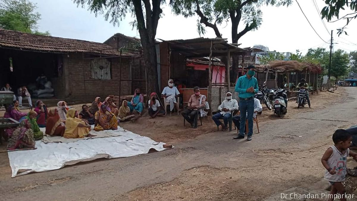 """<div class=""""paragraphs""""><p>A public meeting underway in Chinchkheda village early in May. PHC doctors, block-level officials and local political leaders led the meeting, clearing citizens' doubts regarding the vaccine.</p></div>"""