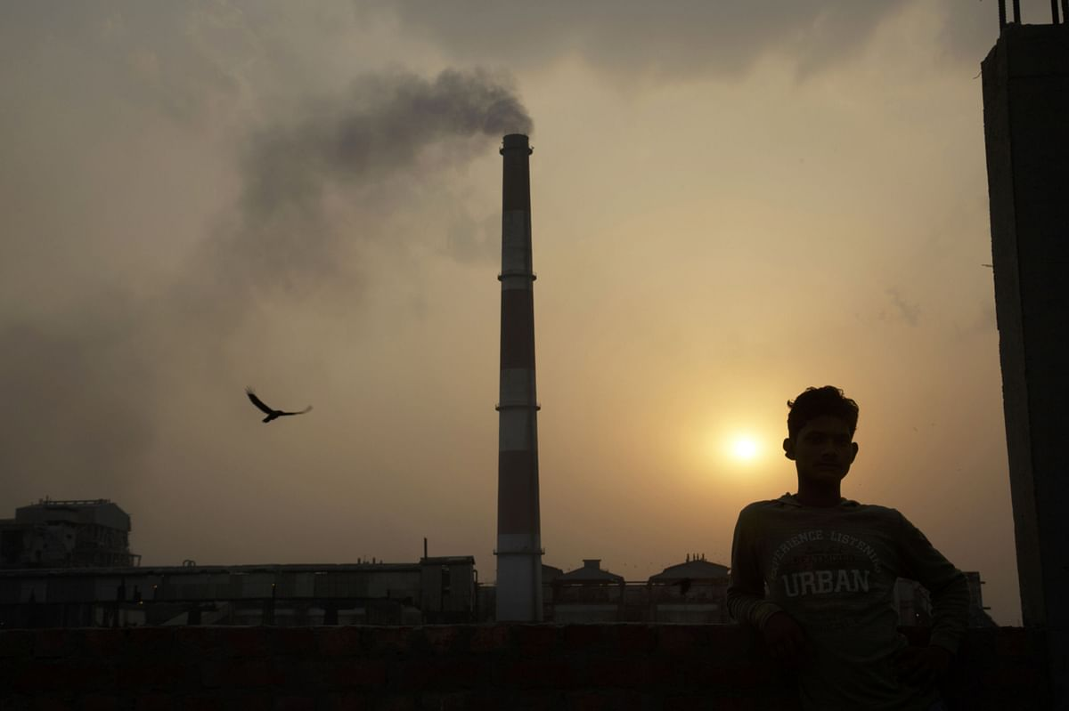"""<div class=""""paragraphs""""><p>Emissions billow at&nbsp;an NTPC coal-fired power plant. (Photographer: Kuni Takahashi/Bloomberg)</p></div>"""