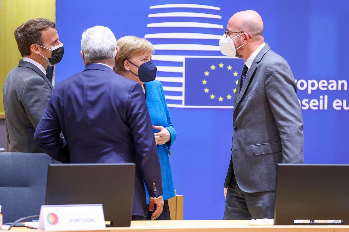 "<div class=""paragraphs""><p>Emmanuel Macron, Angela Merkel,&nbsp;and European Council President Charles Michel, at an EU leaders summit in Brussels, on May 24, 2021. (Photographer: Dursun Aydemir/Anadolu/Bloomberg)</p></div>"