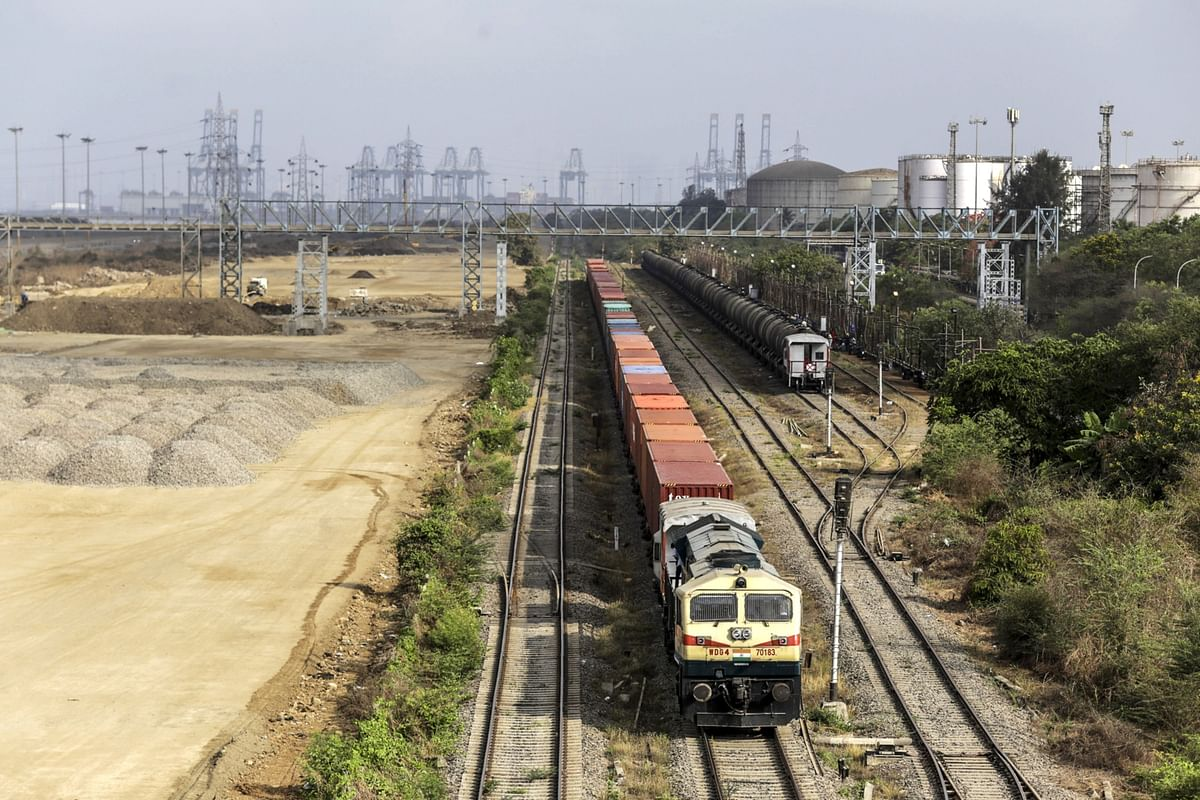 """<div class=""""paragraphs""""><p>Freight trains operating on railway lines in Navi Mumbai, India. (Photographer: Dhiraj Singh/Bloomberg)</p></div>"""