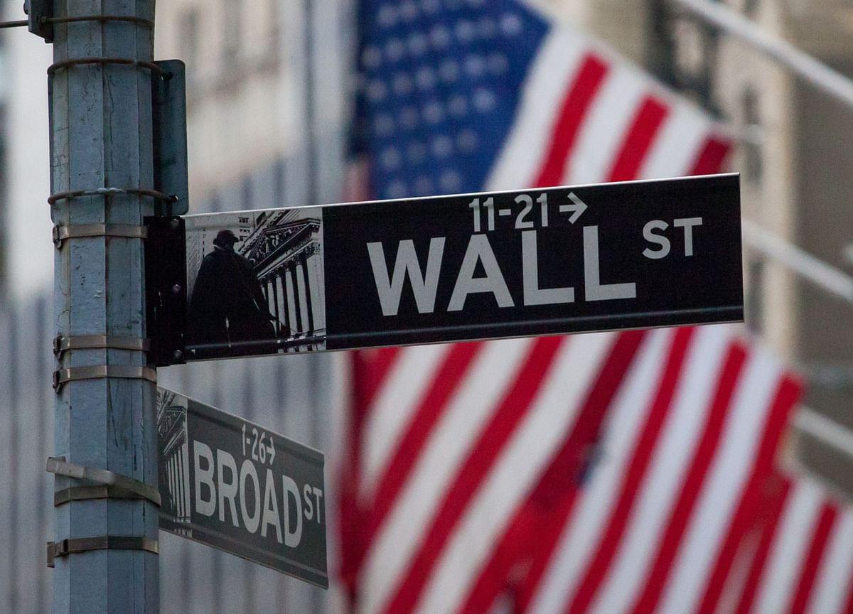 Stocks Tumble, Yield Curve Flattens Amid Fed Reset: Markets Wrap