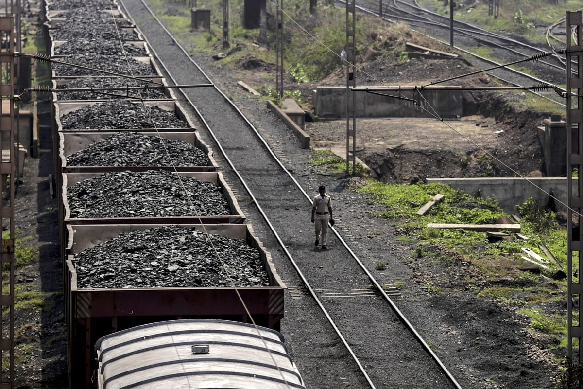 """<div class=""""paragraphs""""><p>A freight train  with coal stands on the tracks in Paradeep, Odisha. (Photographer: Dhiraj Singh/Bloomberg)</p></div>"""