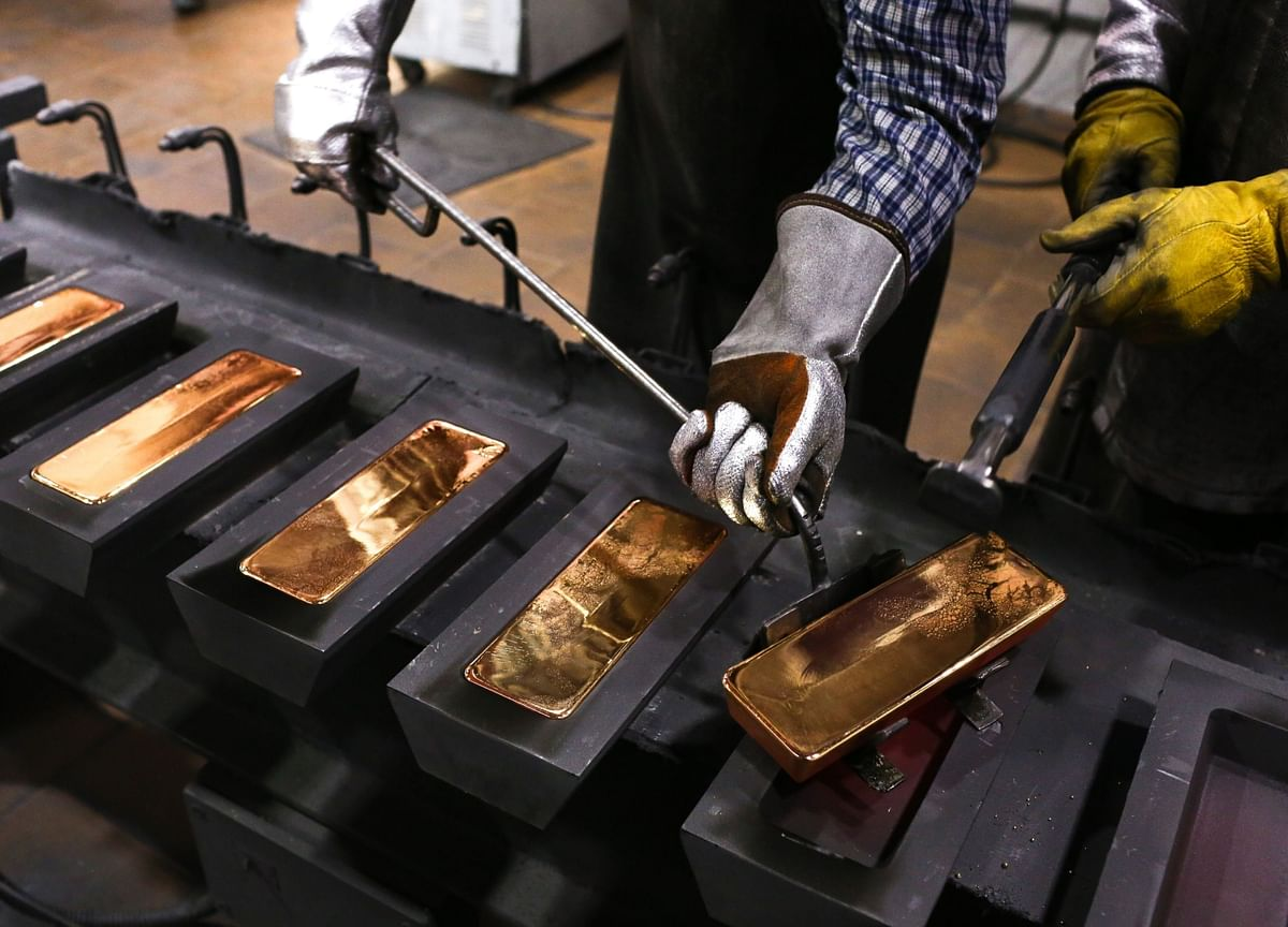 Gold Drops Below $1,800 After Fed Takes More Hawkish Turn