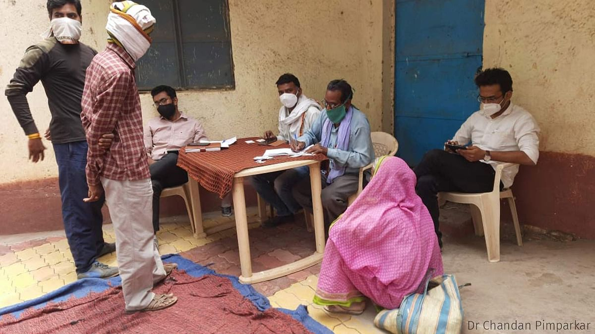 """<div class=""""paragraphs""""><p>Registration of vaccine beneficiaries in Chinchkheda. A PHC doctor registered the eligible citizens using his cellphone.</p></div>"""