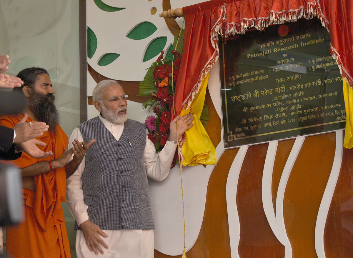 """<div class=""""paragraphs""""><p>Prime Minister Narendra Modi unveils a plaque to mark inauguration of the Patanjali Research Institute, at Haridwar,  on May 3, 2017. (Photograph: PIB)</p></div>"""
