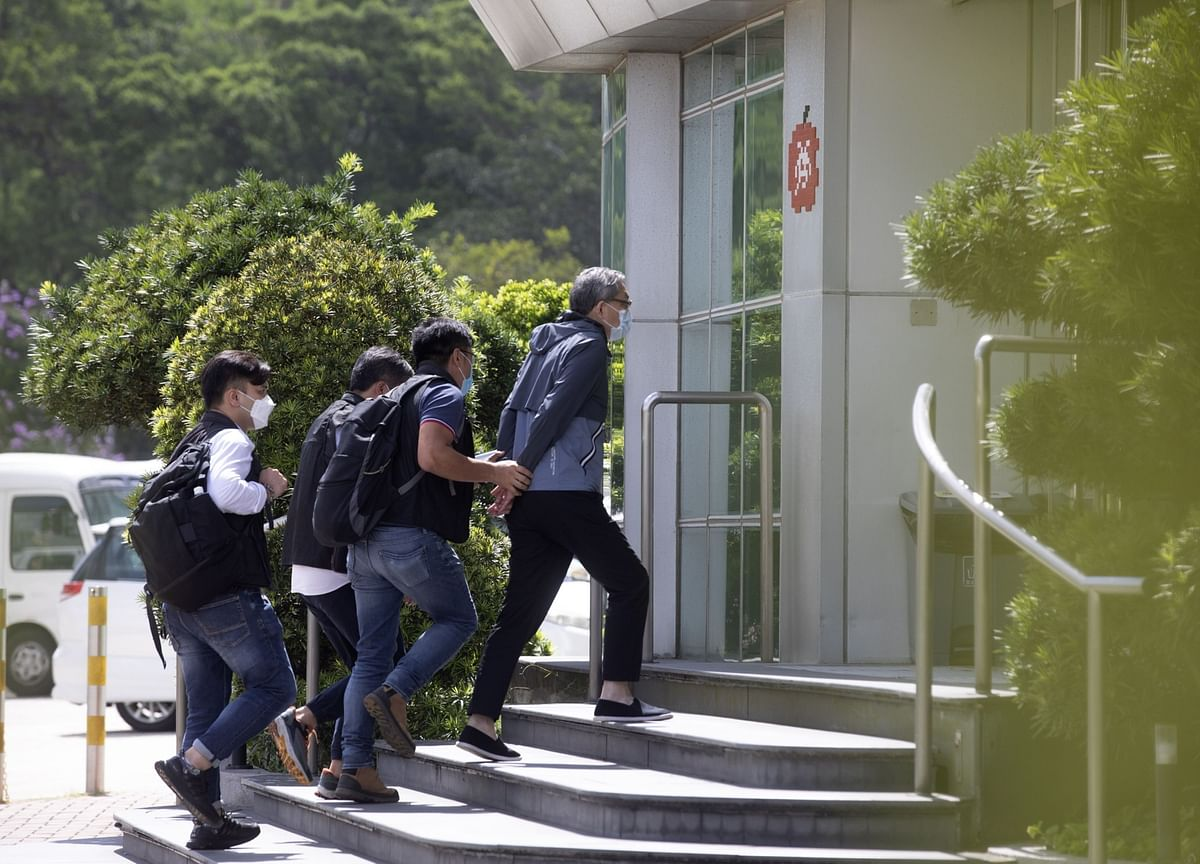 China Hails Hong Kong Journalist Arrests, Warns Media Outlets