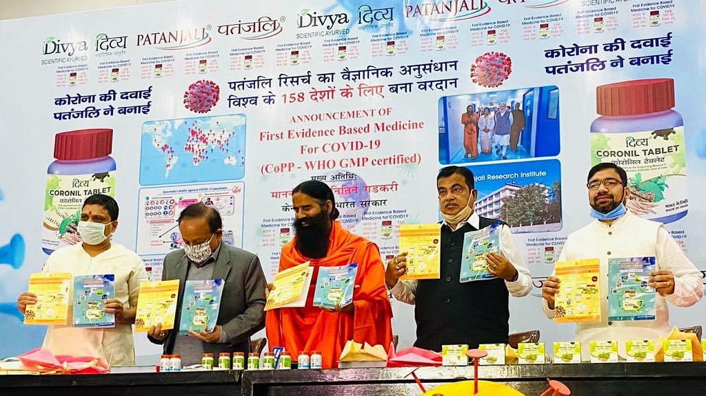 """<div class=""""paragraphs""""><p>Union Ministers Harsh Vardhan and Nitin Gadkari with Balkrishna and Ramdev, at a press conference launching Coronil tablets, on Feb. 19, 2021. (Photograph: Patanjali Ayurved/Twitter)</p></div>"""