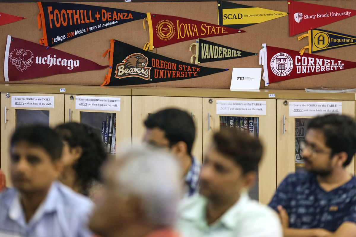 """<div class=""""paragraphs""""><p>Banners of U.S. universities are displayed in a classroom as participants attend a counseling session,&nbsp; in Mumbai. (Photographer: Dhiraj Singh/Bloomberg)</p></div>"""