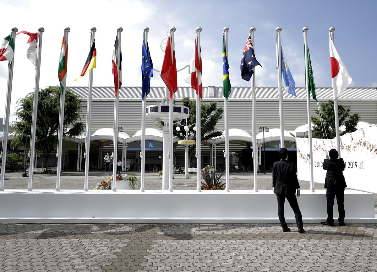 G-20 Finance Chiefs BackTax Deal and Vow to ClearHurdles