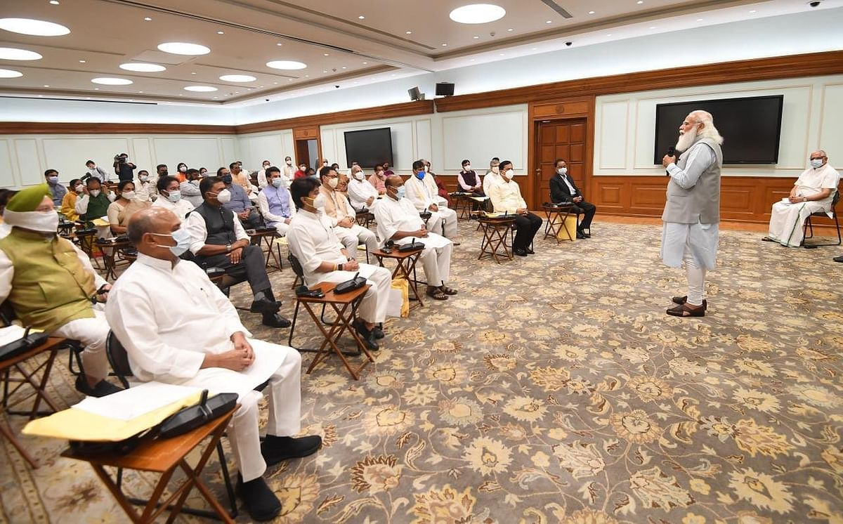 """<div class=""""paragraphs""""><p>Prime Minister Narendra Modi at his offficial residence with the new inductees into his council of ministers, in New Delhi, on July 7, 2021. (Image:  @RajivKumar1/Twitter)</p></div>"""