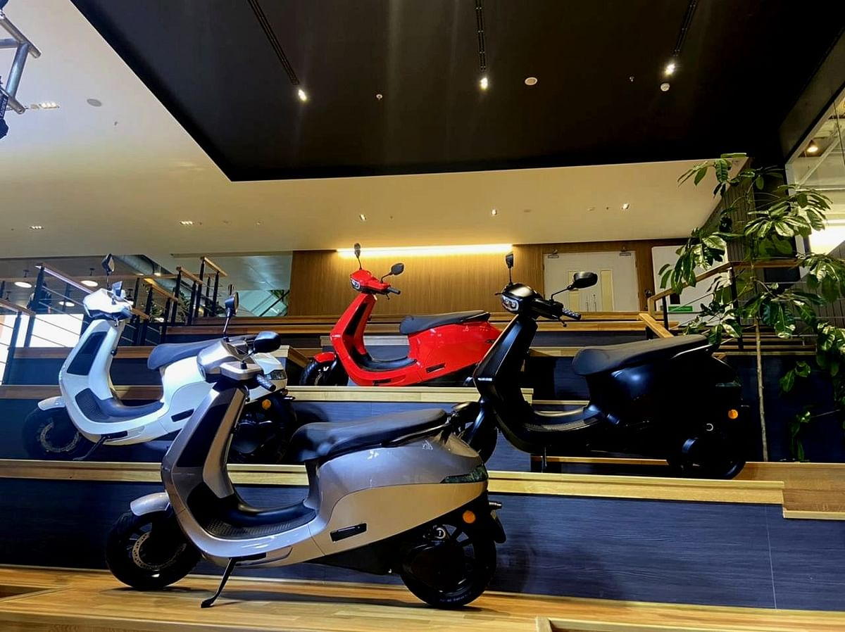 """<div class=""""paragraphs""""><p>Ola electric scooters arranged for a photograph. (Photo: BloombergQuint)</p></div>"""