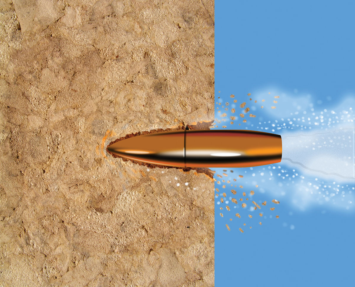 Bullet penetrating a wooden surface
