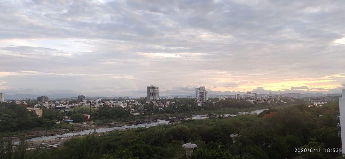 The Mula-Mutha amid a burgeoning cityscape