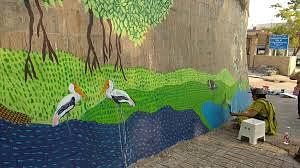 Abha lending a finishing touch to the people's painting at Dr Salim Ali Bird Sanctuary
