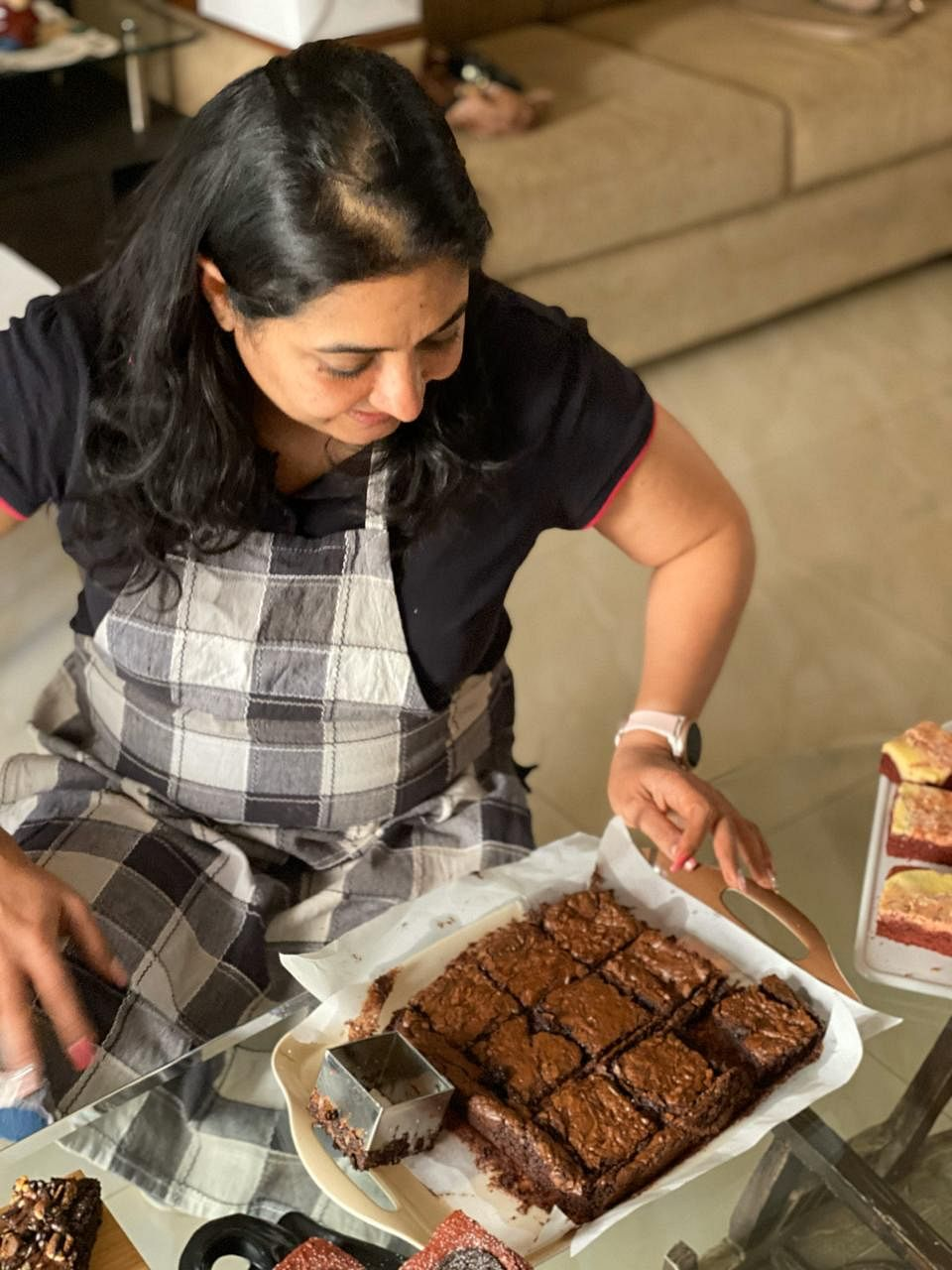 Aju has just baked a batch of chocolate brownies