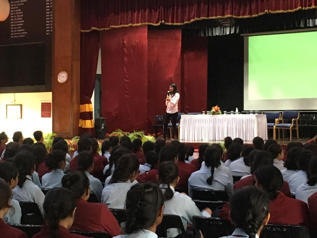 Liyaan conducting a counselling session at a school