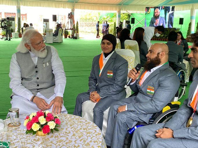 Sakina Khatun and coach Farman Basha sharing thoughts with Indian PM Narendra Modi