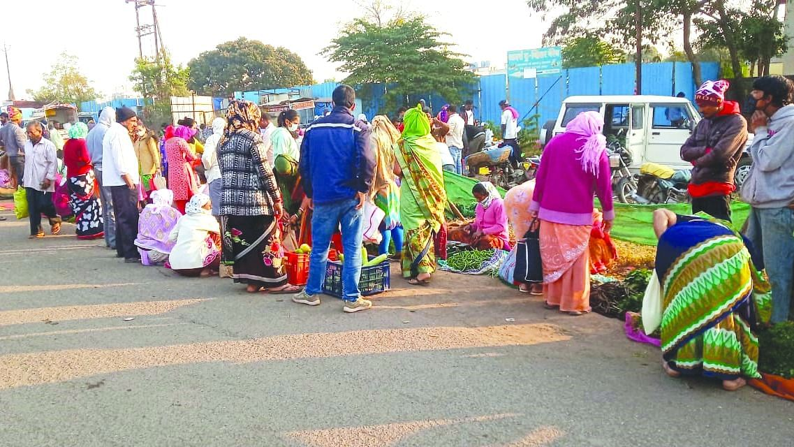 People rush to market areas; Social distancing norms flouted