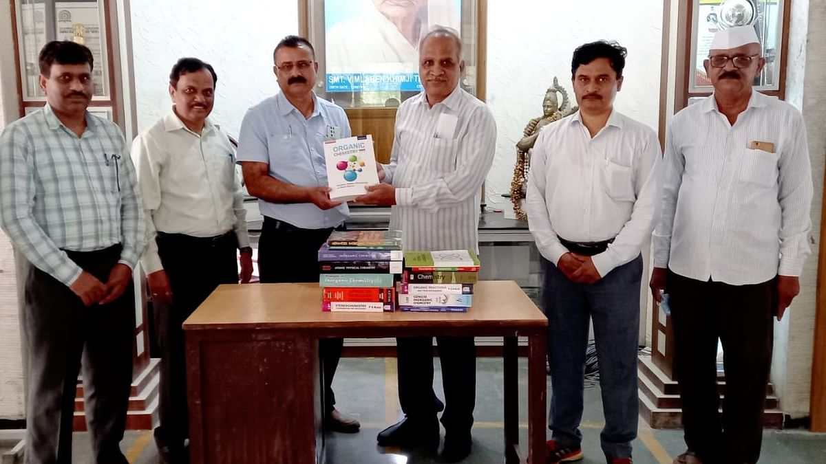 Former Vice Principal gifts reference books to college