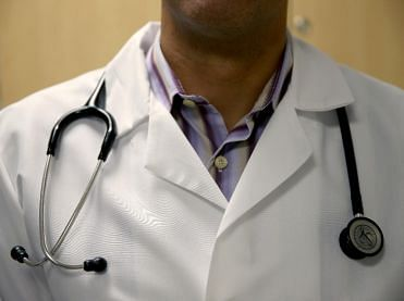 Doctor charged for. concealing travel history